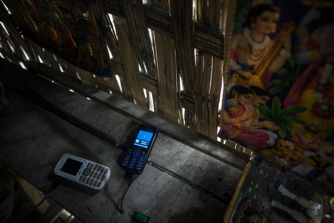 Dhemanji, Assam, India August,2014:   Mobile phones seen at the home of Unmoni Tait (16).  Young girls use cell phones to communicate to the boys before their marriage.   Series on early marriages in Assam, India for Al Jazeera America.       Photo:  Sami Siva