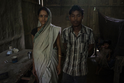 Dhemanji, Assam, India August,2014:   Pink Das (17) and her husband Debojit Das (17) pose for portrait at their home Both Doi village outside of Dhemanji town.  Pink Das was married when she was 12 years 6 months old and has a 18 months old child and now she is pregnant.   Series on early marriages in Assam, India for Al Jazeera America.       Photo:  Sami Siva