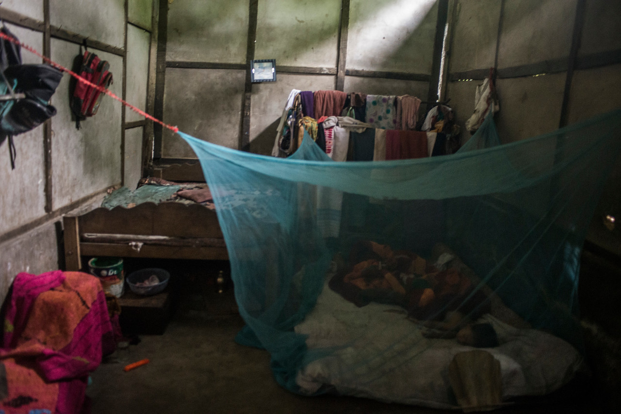 Dhemanji, Assam, India August,2014:   Typical view of a family's bedroom in  Simen Koi Bata village. Young families live in a small houses where their  children often share the room with their parents.    Series on early marriages in Assam, India for Al Jazeera America.       Photo:  Sami Siva
