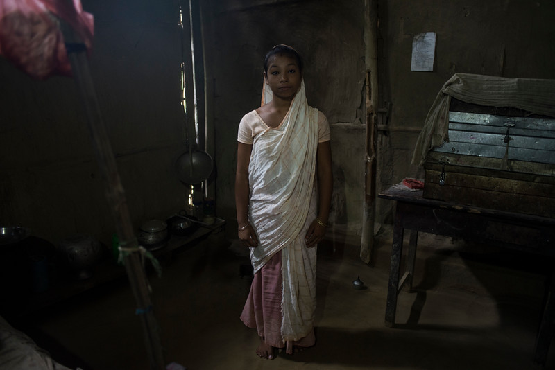 Dhemanji, Assam, India August,2014:   Vandana Das(16), married two yeas ago when she was 14 posses for a photograph at her home in Botha Doi Village just outside of Dhemanji town.    Series on early marriages in Assam, India for Al Jazeera America.       Photo:  Sami Siva