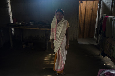 Dhemanji, Assam, India August,2014:   Simpy (13) from Guyekhanna village poses for a a portrait at her home; her husband works in the southern state Kerala which is nearly 4000 KMs away from her home.    Series on early marriages in Assam, India for Al Jazeera America.       Photo:  Sami Siva