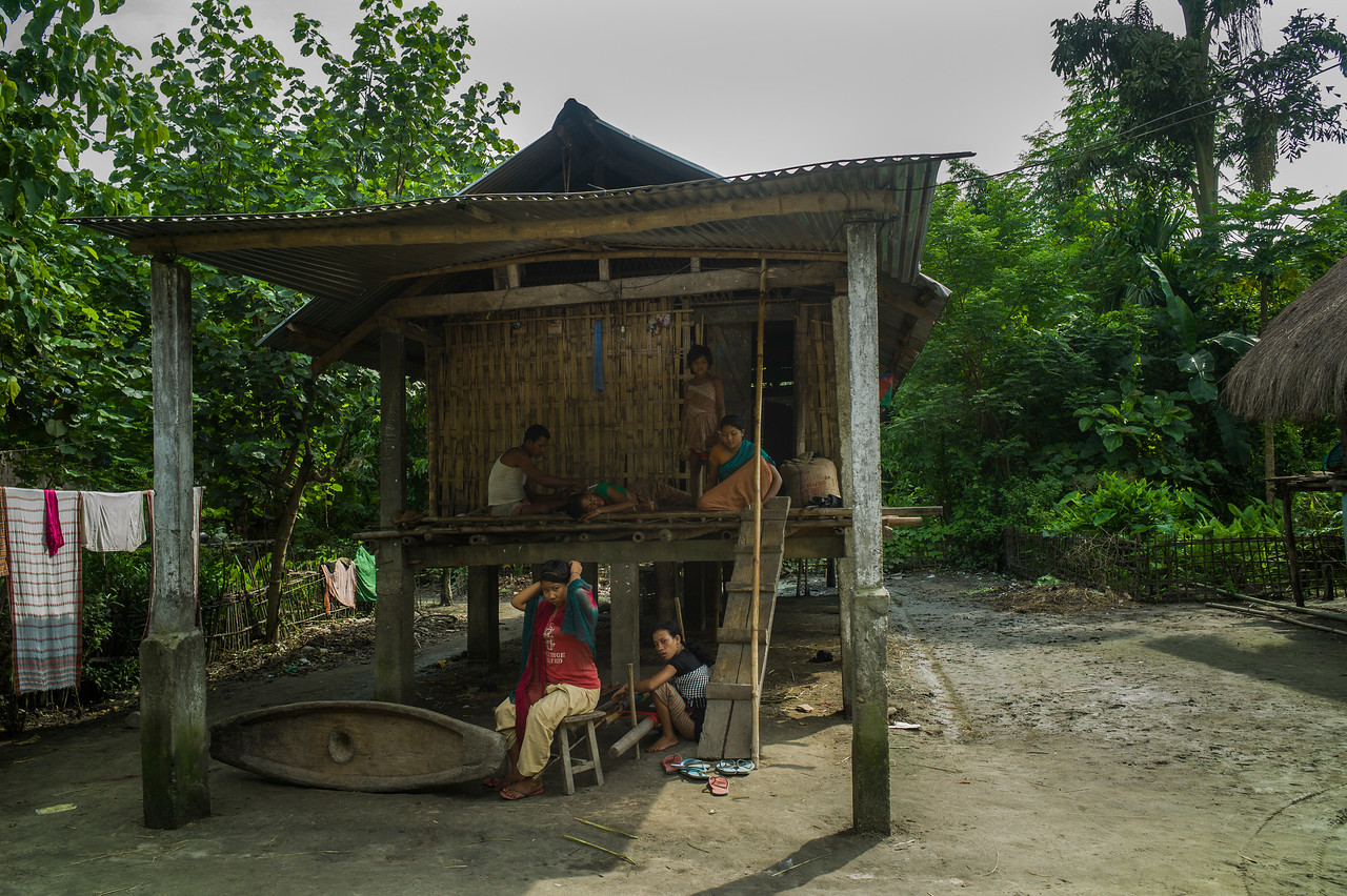 Dhemanji, Assam, India August,2014:   Tait family in Sali Kuchi Village. The family members live together in a small house typically has a one room and a kitchen.   Series on early marriages in Assam, India for Al Jazeera America.       Photo:  Sami Siva