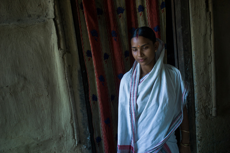 Dhemanji, Assam, India August,2014:   Ribha Das (16) married at 14 posses for a portrait at her home in Simen Koi Bata village.    Series on early marriages in Assam, India for Al Jazeera America.       Photo:  Sami Siva