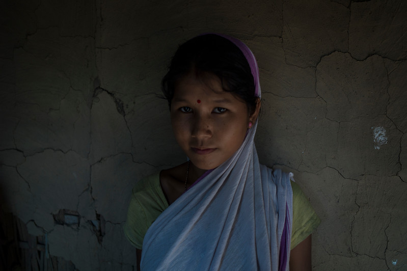 Dhemanji, Assam, India August,2014:   Lokimai Das (17) married when she was 14  seen at a neighbours home in Simen Koi Bata village in Dhemanji District, Assam.   Series on early marriages in Assam, India for Al Jazeera America.       Photo:  Sami Siva