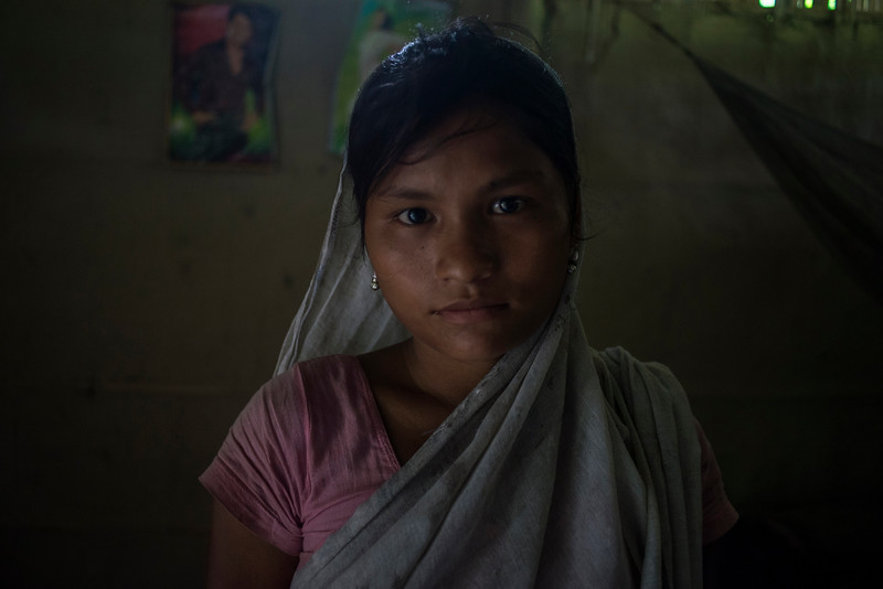 Dhemanji, Assam, India August,2014:   Debo Jani (16) was married at 12 and she has two kids.  She poses for a portrait at her house in Guyekhanna village.    Series on early marriages in Assam, India for Al Jazeera America.       Photo:  Sami Siva