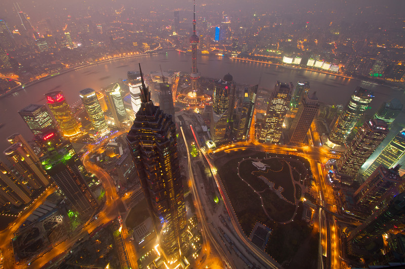 Shanghai (and its haze) as shown from the top of the 1600ft-tall Shanghai World Financial Center. Puxi is shown at the top of the image, Pudong at the bottom with the Huangpu river separating the two.