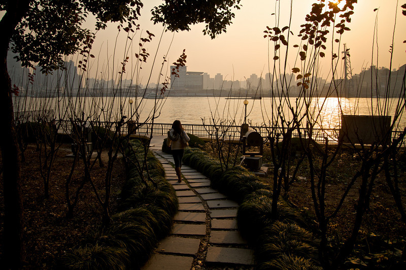 Walking down a path towards the Huangpu River in Pudong.
