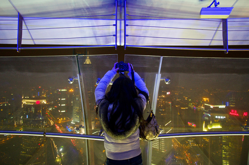 Photographing the Shanghai skyline from the Oriental Pearl Tower.