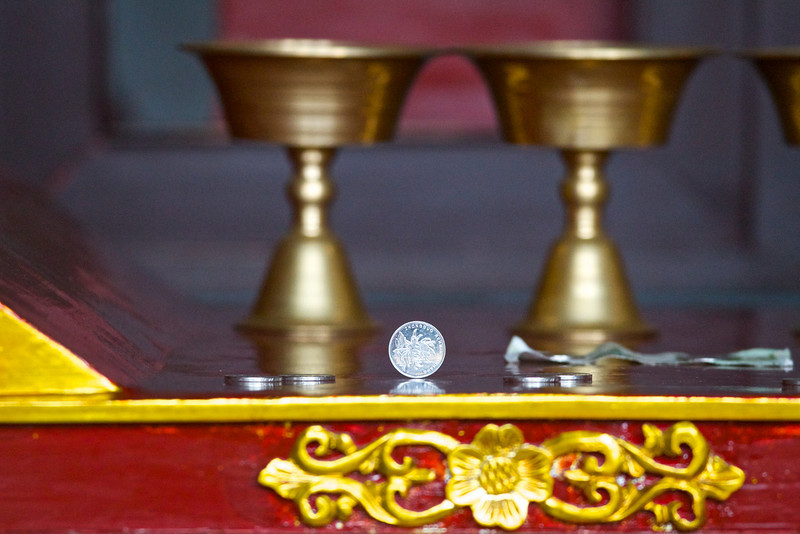 Offerings are made for good luck in a Buddhist temple.