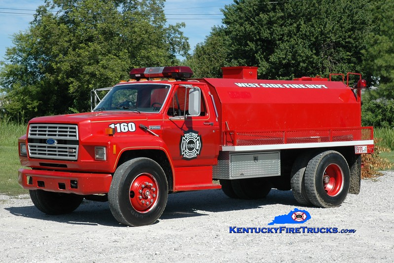 <center> West Side  Tanker 1160  <br> x-Paris, TN  <br> 1986 Ford F-700/Local 250/1800 <br> Greg Stapleton photo </center>