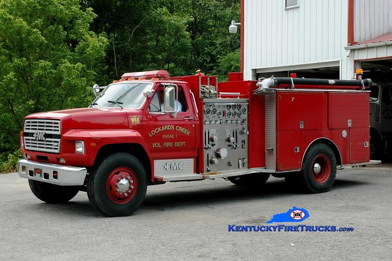 <center> RETIRED <BR> Lockards Creek  Engine 1<br> 1987 Ford F/FMC 1000/1000  <br> Greg Stapleton photo </center>