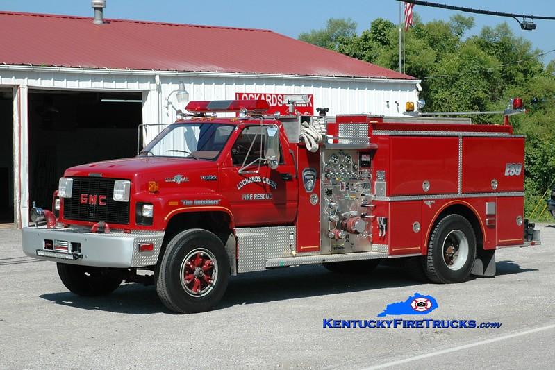 <center> RETIRED <br> Lockards Creek  Engine 99 <br> x-Liberty Twp, OH <br> 1992 GMC Top Kick/Grumman 1000/1000  <br> Greg Stapleton photo </center>