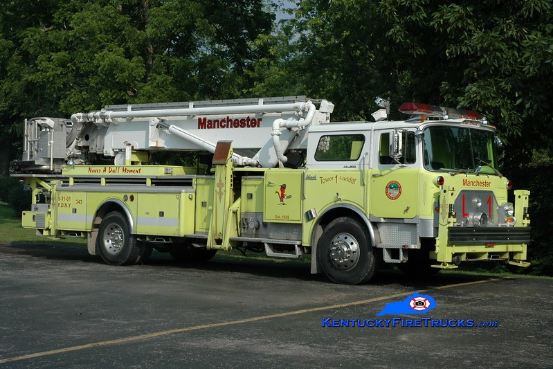 <center> RETIRED <br> Manchester  Ladder 1 <br> x-Copiague, NY <br> 1972 Mack/Baker 75' Aerialscope <br> Greg Stapleton photo </center>