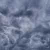 Dark mammatus clouds boil overhead