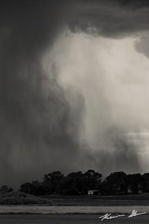 A downburst sends out a rain foot across the Iowa landscape