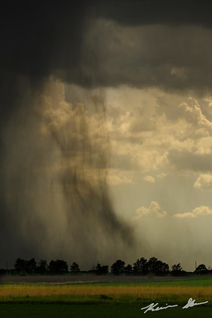 A downburst sends out a rain foot across the Iowa landscape