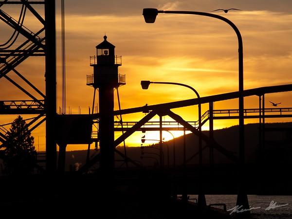 Sunset through the span of the lift bridge