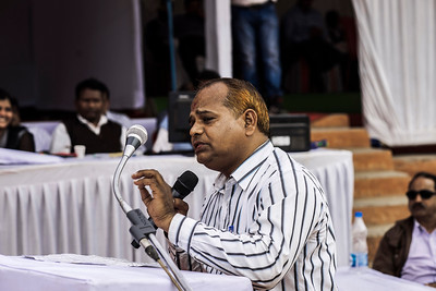 Chattisgarh, India, February 2015:   A supporter for the expansion  of the Kusumunda coal  field speaks at the public hearing organzied by South Eastern Coalfields Limited (SECL).  Photographs for a story on land allocation for coal mines in Chattisgarh.  Modi's new government in the centre has relaxed the environmental regulations so the land can be allocated to both public and private sector companies easily.   Photo by Sami Siva for Al Jazeera America.
