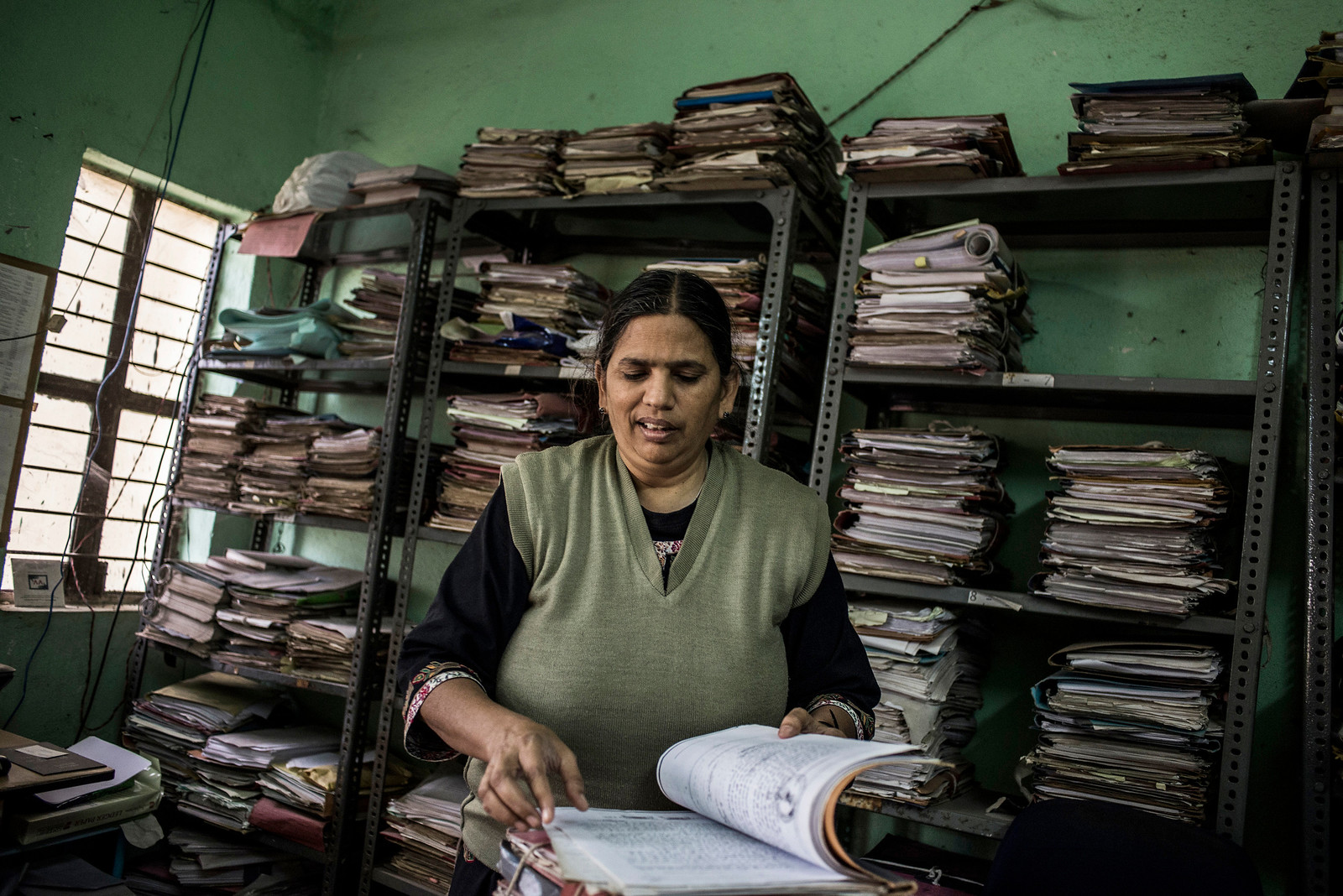 Chattisgarh, India, February 2015:   Social worker and lawyer Sudha Bharadwaj seen at her office in Bilaspur. Her organization represents the tribals whose land has been allocated illegally to the coal mining companies.   Photographs for a story on land allocation for coal mines in Chattisgarh.  Modi's new government in the centre has relaxed the environmental regulations so the land can be allocated to both public and private sector companies easily.   Photo by Sami Siva for Al Jazeera America.