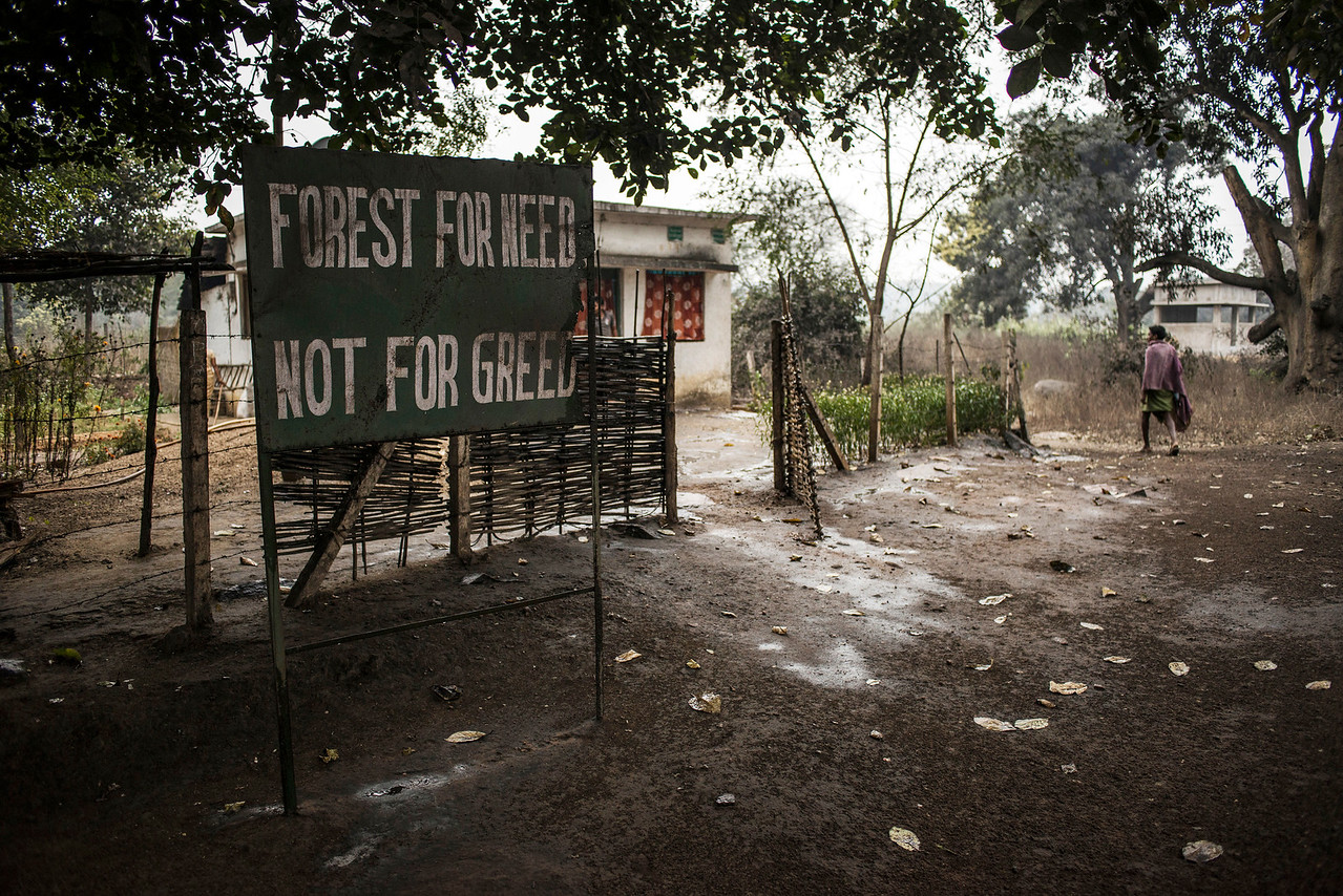 Chattisgarh, India, February 2015:   A sign post erected by the forest department reads - FOREST FOR NEED AND NOT FOR GREED - seen near the Hasdeo Arand forest area of the Raigarh District where large number of coal mining activities take place.   Photographs for a story on land allocation for coal mines in Chattisgarh.  Modi's new government in the centre has relaxed the environmental regulations so the land can be allocated to both public and private sector companies easily.   Photo by Sami Siva for Al Jazeera America.