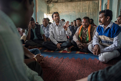 Chattisgarh, India, February 2015:   Community leaders from the  village of Khodri discuss their plan of action for an upcoming  public hearing, in which government officials will hear the concerns of the citizens from the villages whose land is to be taken over by the coal mining companies for their proposed expansion.    Photographs for a story on land allocation for coal mines in Chattisgarh.  Modi's new government in the centre has relaxed the environmental regulations so the land can be allocated to both public and private sector companies easily.   Photo by Sami Siva for Al Jazeera America.