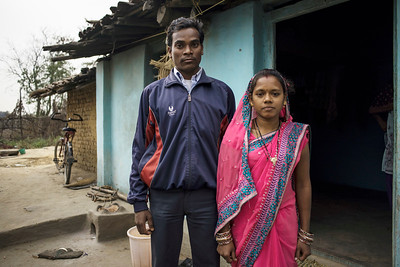 Chattisgarh, India, February 2015:   Sarpanch  (Name to be confirmed) / Chief of Pali villages which is allocated in the proposed expansion of coal mining area poses for a photograph at her home with her husband.   Photographs for a story on land allocation for coal mines in Chattisgarh.  Modi's new government in the centre has relaxed the environmental regulations so the land can be allocated to both public and private sector companies easily.   Photo by Sami Siva for Al Jazeera America.