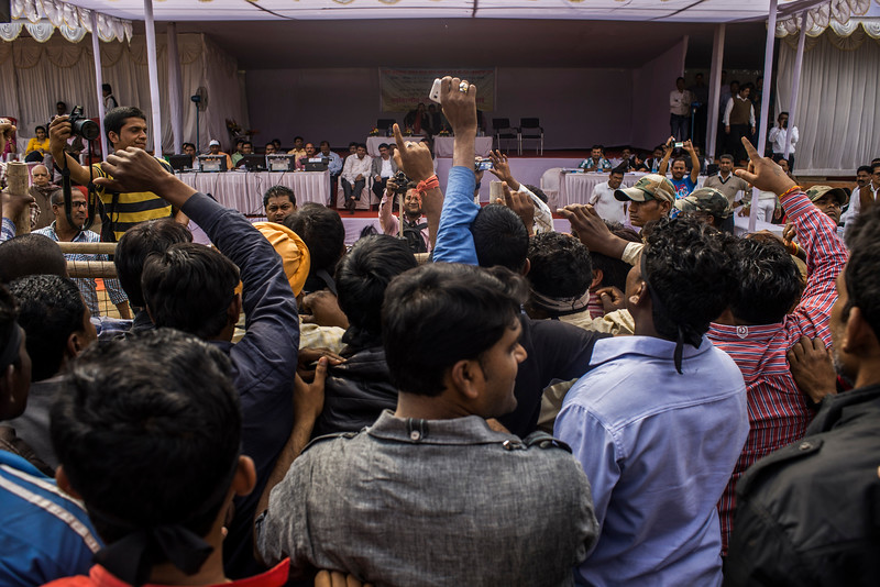 Chattisgarh, India, February 2015:   Public express their opposition to the proposed expansion of Kusumunda coal mine sites at a public hearing meeting organized by local government officials.   Photographs for a story on land allocation for coal mines in Chattisgarh.  Modi's new government in the centre has relaxed the environmental regulations so the land can be allocated to both public and private sector companies easily.   Photo by Sami Siva for Al Jazeera America.