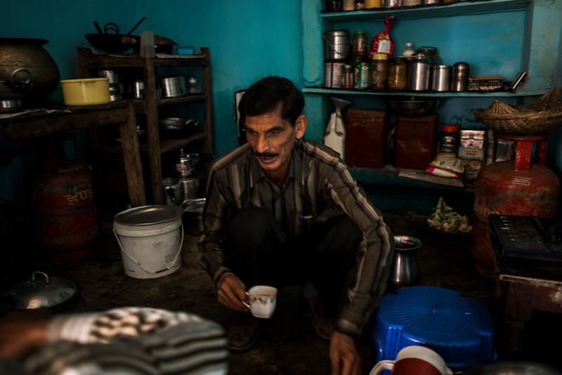 Chattisgarh, India, February 2015:   Hari Hara Prasad Patel  makes tea at his home. His ancestral home is part of the area proposed for the expansion of Gare Palma coal fields in Raigarh district.    Photographs for a story on land allocation for coal mines in Chattisgarh.  Modi's new government in the centre has relaxed the environmental regulations so the land can be allocated to both public and private sector companies easily.   Photo by Sami Siva for Al Jazeera America.