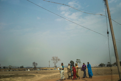 Chattisgarh, India, February 2015:   Women in the village of Khodri walk to the community center to attend a meeting with other villagers about the proposed expansion of coal fields.   Photographs for a story on land allocation for coal mines in Chattisgarh.  Modi's new government in the centre has relaxed the environmental regulations so the land can be allocated to both public and private sector companies easily.   Photo by Sami Siva for Al Jazeera America.