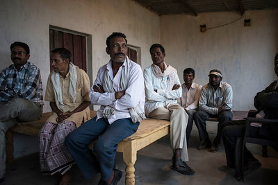 Chattisgarh, India, February 2015:   Villagers from the village of Pali seen at the village chief's house. The villagers plan to reject the expansion of Kusumunda coal fields.   Photographs for a story on land allocation for coal mines in Chattisgarh.  Modi's new government in the centre has relaxed the environmental regulations so the land can be allocated to both public and private sector companies easily.   Photo by Sami Siva for Al Jazeera America.