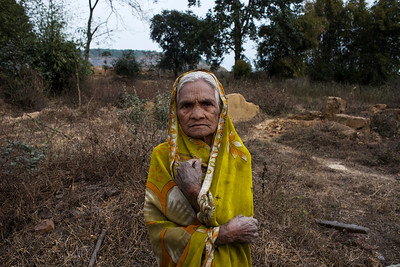 Chattisgarh, India, February 2015:   Surajbai (80) from the village of Barkutta lost her home to coal mining operations at the Kusumunda.  She poses for a photograph at site of her old home, which was destroyed. Her land is now under the proposed area of expansion.    Photographs for a story on land allocation for coal mines in Chattisgarh.  Modi's new government in the centre has relaxed the environmental regulations so the land can be allocated to both public and private sector companies easily.   Photo by Sami Siva for Al Jazeera America.
