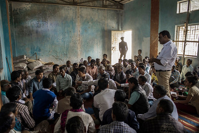 Chattisgarh, India, February 2015:   Laxmi Chauhan, a local activist, speaks to community leaders from the village of Khodri during their discussions on their plan of action for an upcoming  public hearing.    Photographs for a story on land allocation for coal mines in Chattisgarh.  Modi's new government in the centre has relaxed the environmental regulations so the land can be allocated to both public and private sector companies easily.   Photo by Sami Siva for Al Jazeera America.