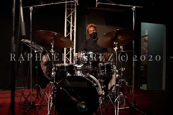 James Carter concert in Paris, Oct 2020, with his Organ Trio at New Morning. Alex White on drums during soundcheck wearing facemask durig the Cornavirus pandemy.