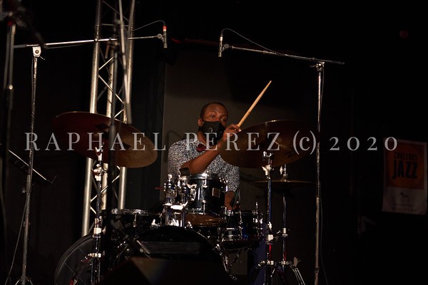 James Carter concert in Paris, Oct 2020, with his Organ Trio at New Morning. Alex White on drums wearing facemask during the coronavirus pandemy.