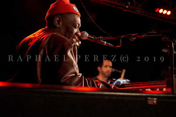 Bluesman Lucky Peterson concert in Paris New Morning on March 2019. Lucky during rehearsal with drummer Raul Valdes in background.