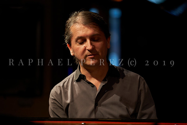 Tamir Hendelman pianist in a trio for a concert in Duc des Lombards Paris.  Rehearsal time before the show. September 2019.