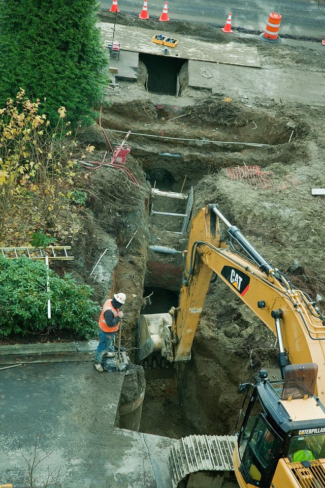 Rerouting a water main next to building 43.