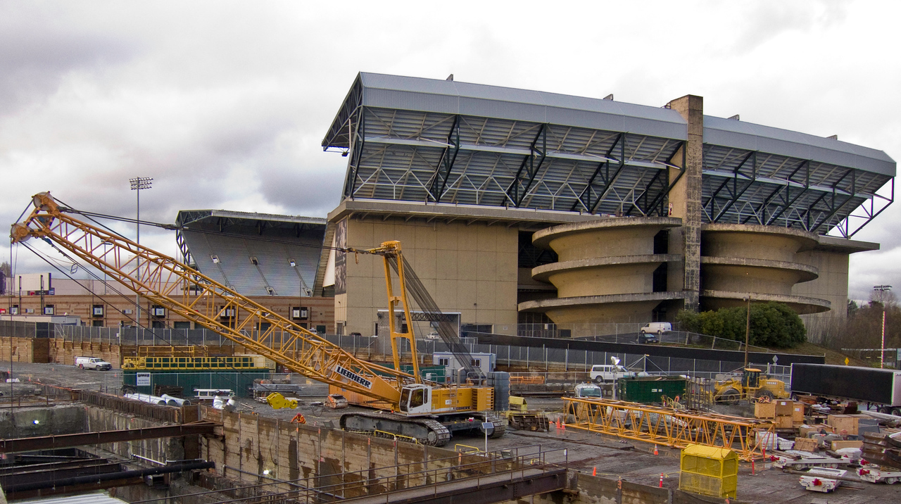 The stadium in April, 2011. The Sound Transit Link Light Rail station excavation is in the foreground.