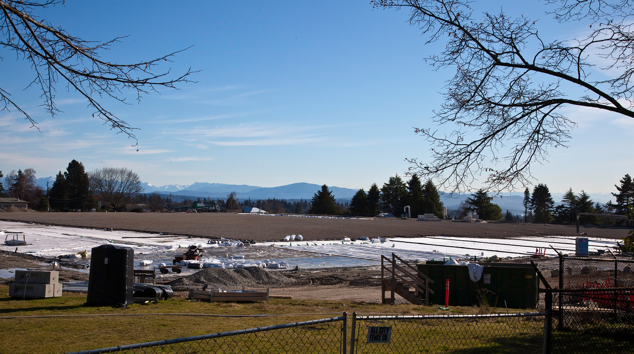 February 6, 2012, the lid is complete and being covered with waterproofing and dirt.