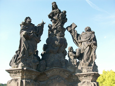 Statue of the Madonna, St. Dominic and St. Thomas (1708) on the Charles Bridge in Prague.