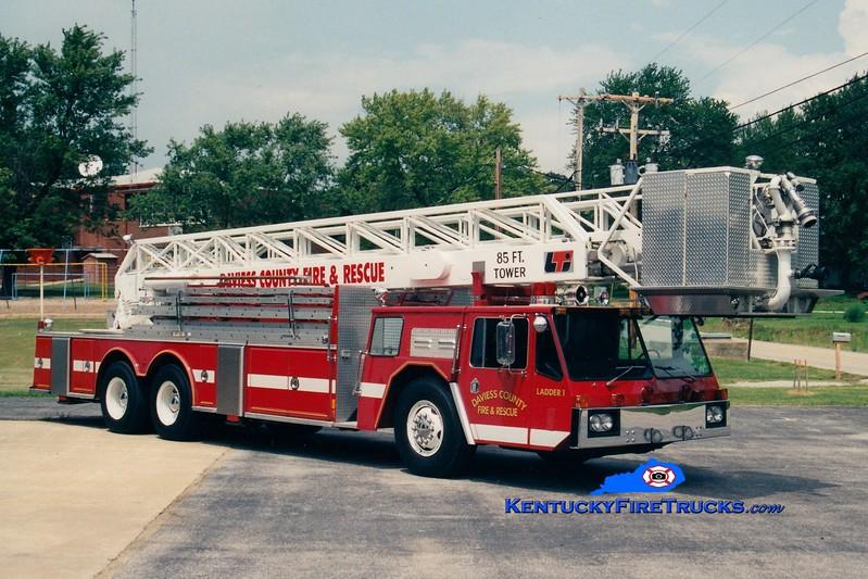 <center> RETIRED <br> Daviess County Ladder 1 <br> x-Owensboro, KY <br> 1976 Oshkosh/Conestoga/LTI 85' <br> Greg Stapleton photo <br> </center>