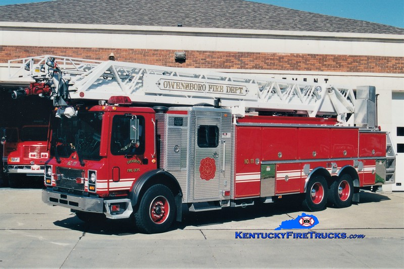 RETIRED<br /> Owensboro Ladder 112 <br /> x-Ladder 111<br /> 1999 Mack MR/Ferrara/RK 109'<br /> Greg Stapleton photo