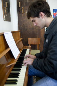 I am learning to play the piano!  Notice the intense look of concentration. It is freaking hard!   I can read music now though. O the things you learn in the Peace Corps!