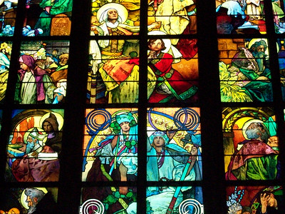 Stained glass windows inside St. Vitas Cathedral in Prague Castle.