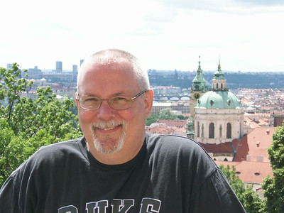 Ed outside Prague Castle with Old Town Prague in the background.