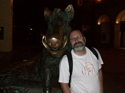 Joe with a statue of a boar in Munich.