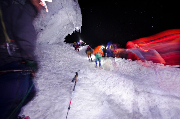 Teams of climbers on the ascent