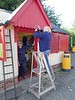 Sue and Jacky repaint the station shop