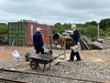 Alan and Adrian mix concrete for the new toilet block