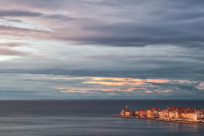 The old town of Piran juts out into the Adriatic at sunset.